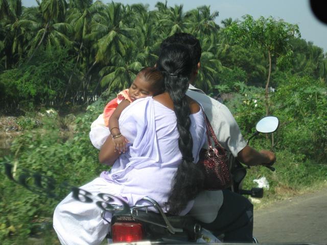Baby balancing on motor bike