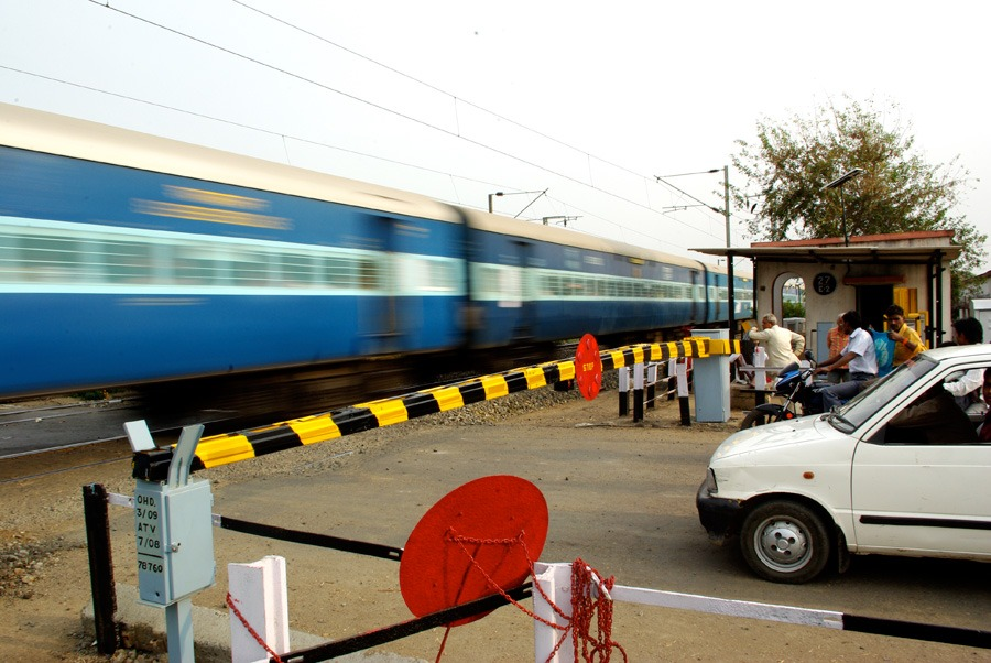 blue-train-crossing-india