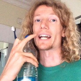 brushing-teeth-with-bottled-water-in-india