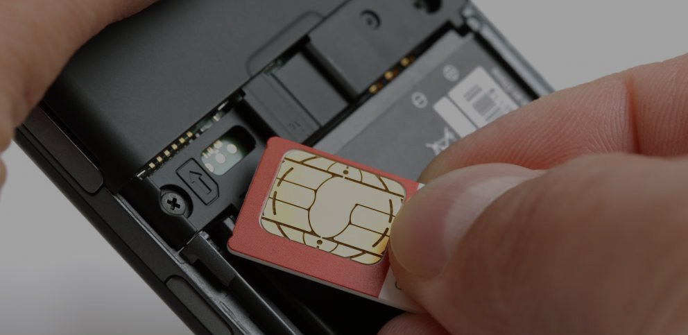 sim-card-being-placed-into-a-mobile-phone copy