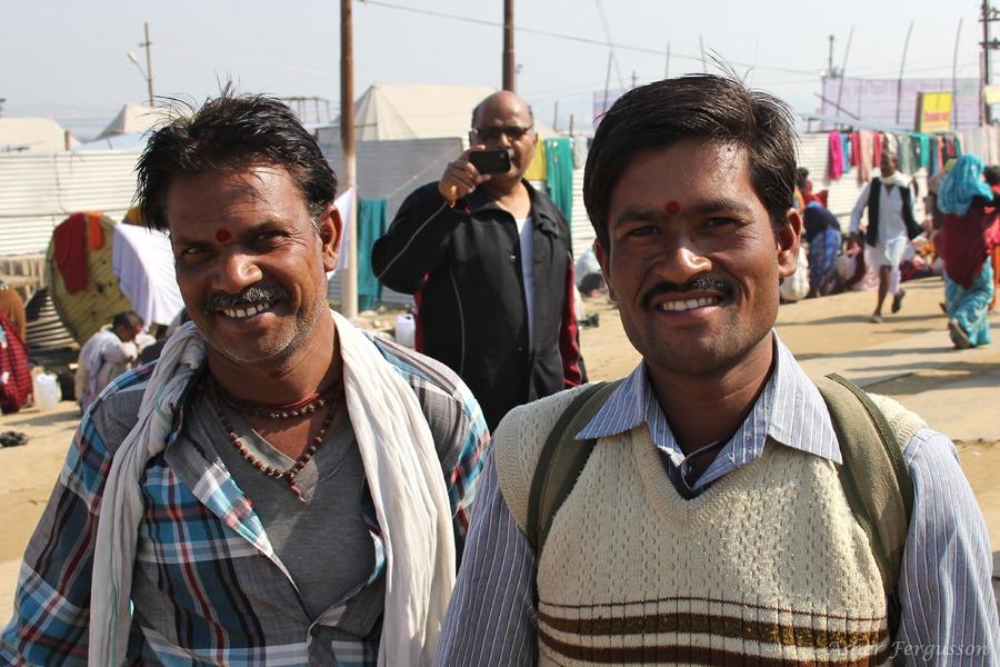 Two Indian men smiling