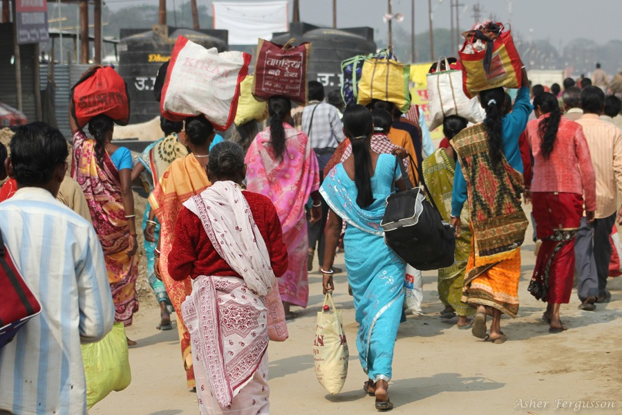 Indian ladies carrying bags on their heads