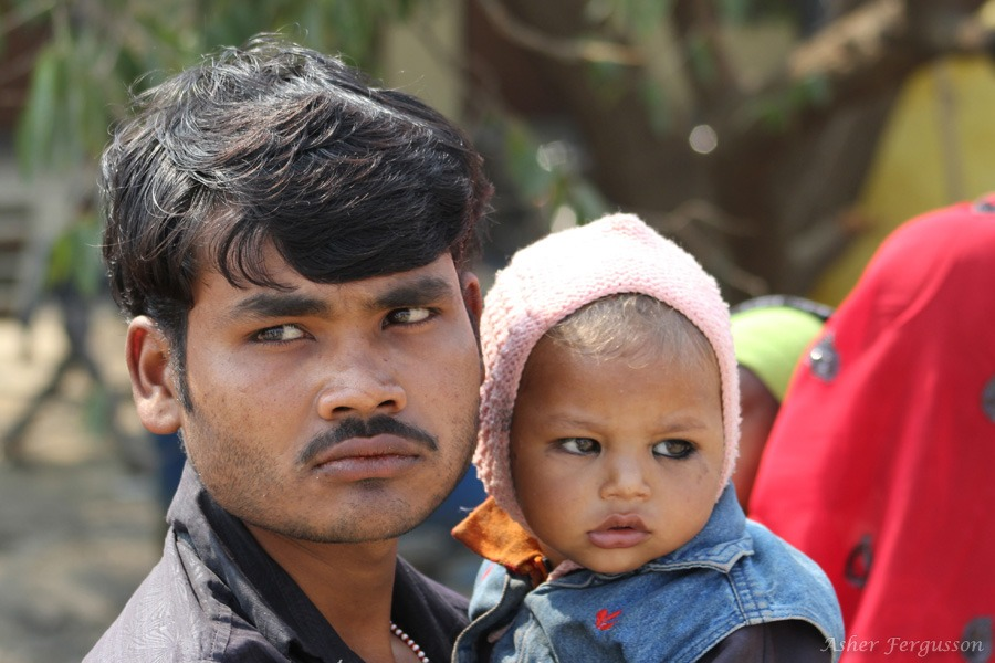 Indian man with child
