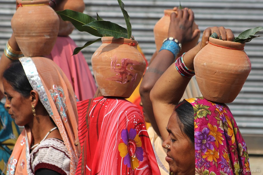 Indian ladies with earthen pots on head