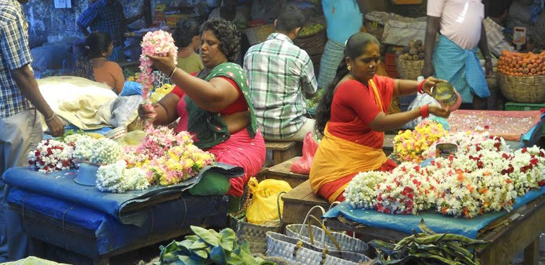 women-making-flower-garlands-india