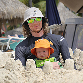 asher with kingsley at the beach in aruba
