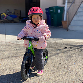 toddler on a balance bike
