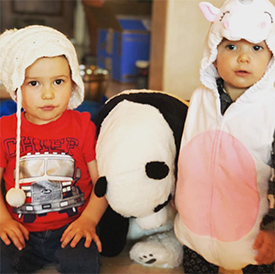 16-month-old playing dress-ups