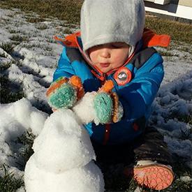 Kingsley building a snowman