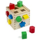 Practice Shapes with a Wooden Shape Sorter