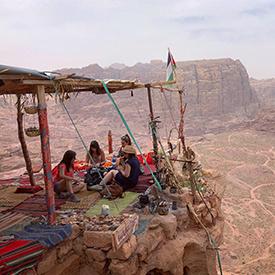 ladies eating food on cliff in jordan