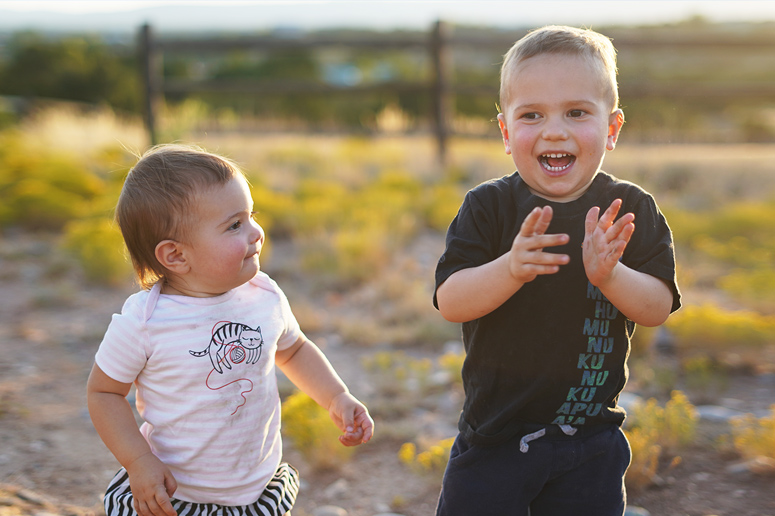 kingsley and aurora playing  outside in santa fe