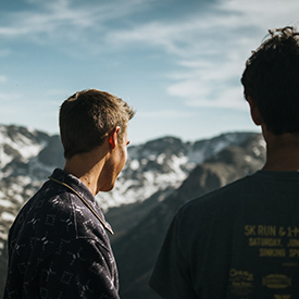 Friends looking at the rocky mountains