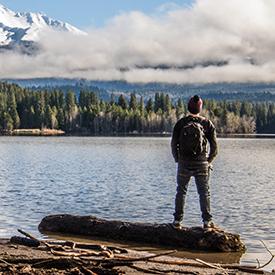 Guy looking at lake