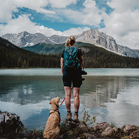 lady with dog by the lake