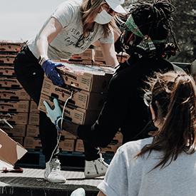 Volunteers unloading