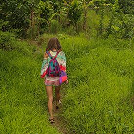 Woman hiking Kalalau Trail