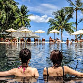 Women in pool at a resort