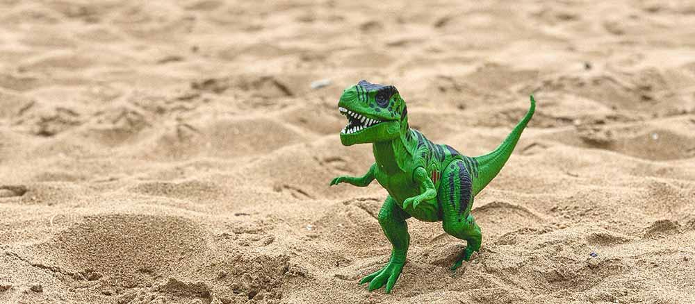 dinosaur in sand
