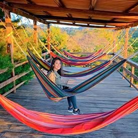 girl in hammock while glamping
