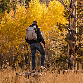 guy hiking in the fall