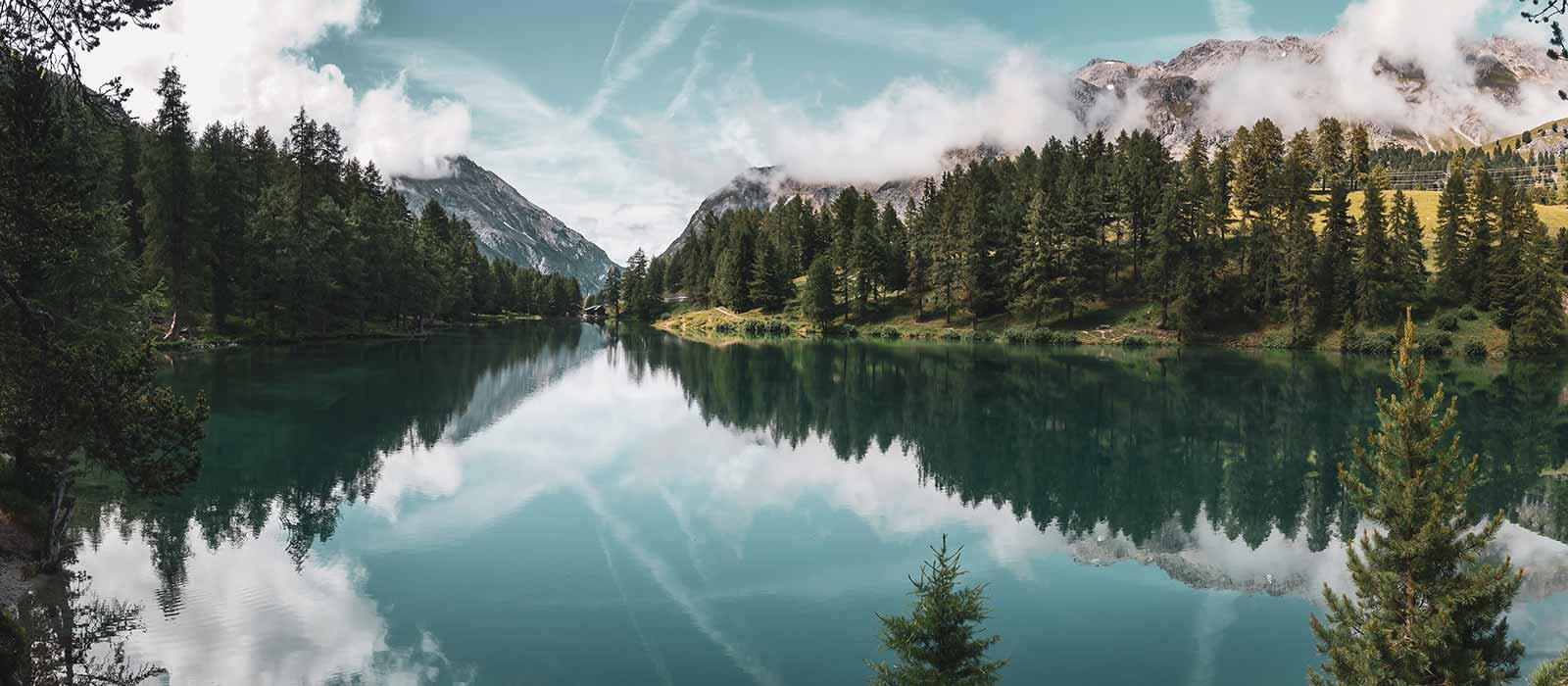 Mountains behind a lake with fresh air