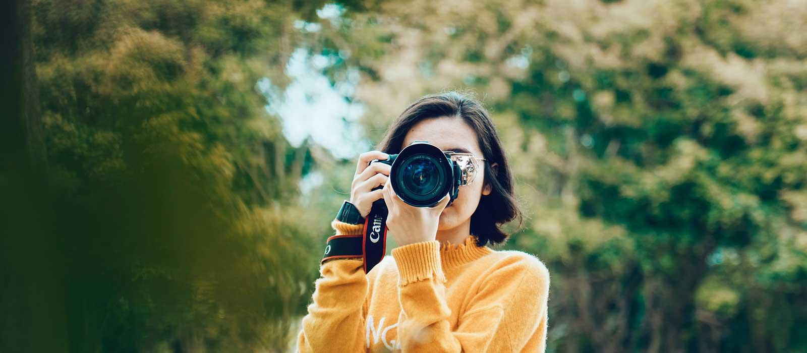 Girl taking photos with digital camera