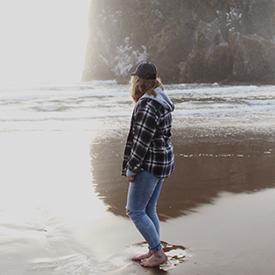 Woman walking along Oregon Coast