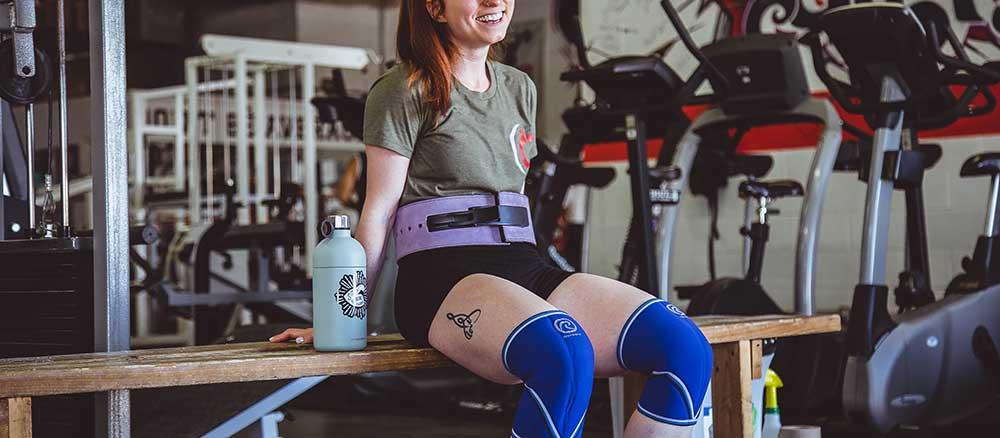 Women wearing a weight lifting belt