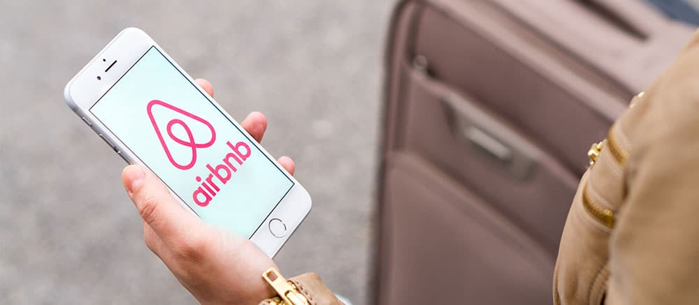 airbnb app in a woman's hand