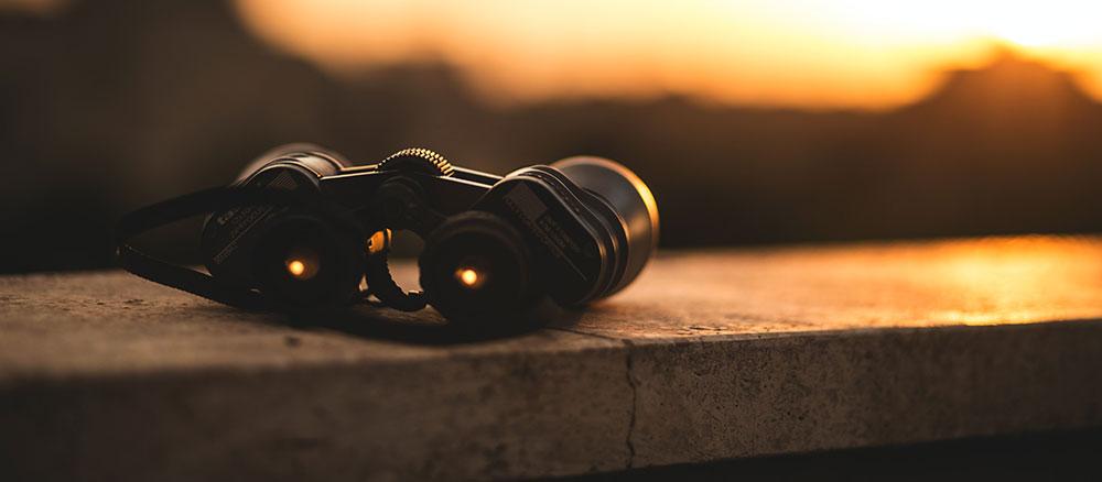 binoculars laying on a ledge