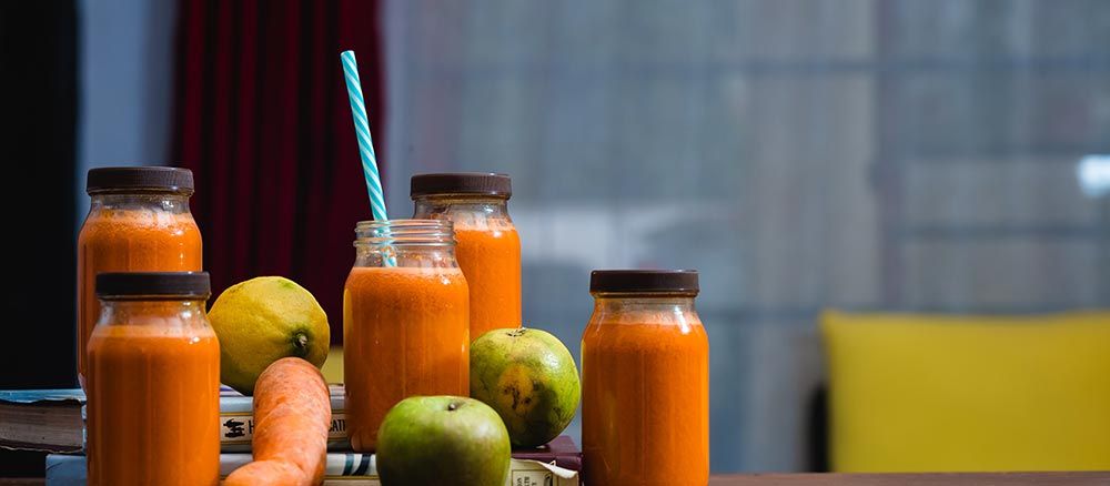 juiced carrot juice in glass containers