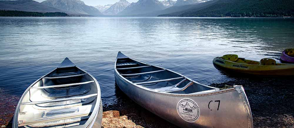 Canoes resting lakeside