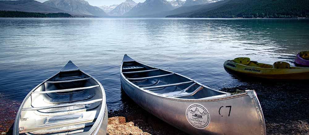 Canoes resting lakeside