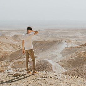 Guy looking out at desert in Israel