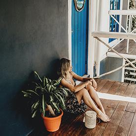 Woman outside hostel room