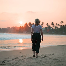 Woman walking on beach in Sri Lanka