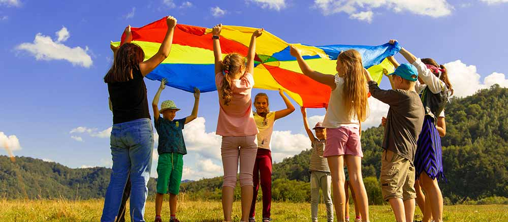 Summer Camper's playing with parachute