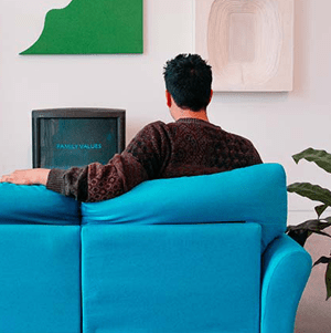 man sitting on couch at airbnb